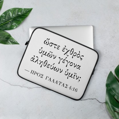 Laptop sleeve (13 inch) with Biblical Greek (Galatians 4:16) on table