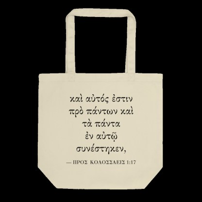 Oyster-colored bilingual tote bag with Biblical Greek (Colossian 1:17) flat on black background