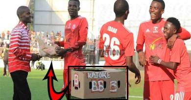 Footballer Hassan Kajoke receives chicken for man of the match award.