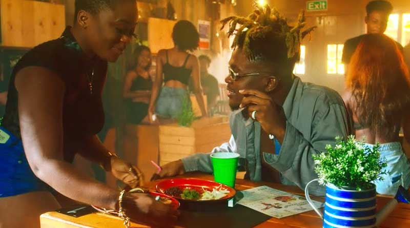 Quamina MP ft Medikal performing Kenkey Seller Remix Official Music Video directed by Director Abass, song produced by Quamina MP.