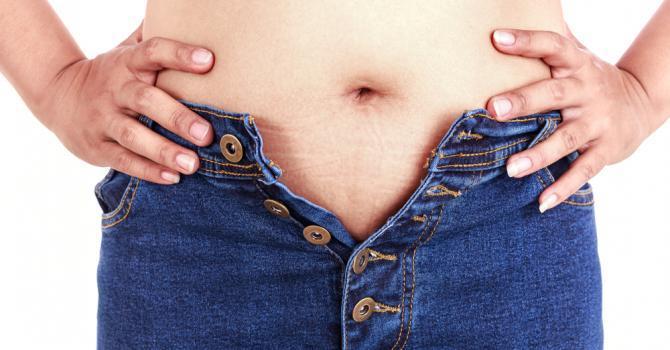 pourquoi prendre des kilos à la ménopause
