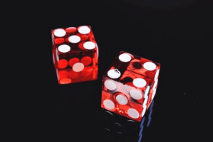 two red dices on the table