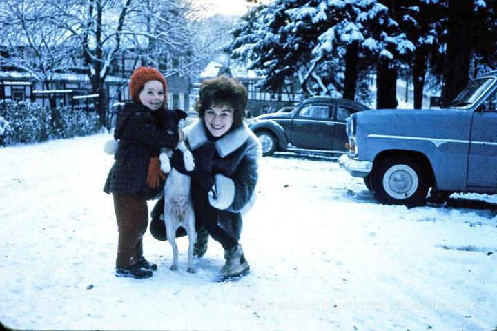 Gertrud Biewer with her niece and a dog in Winter