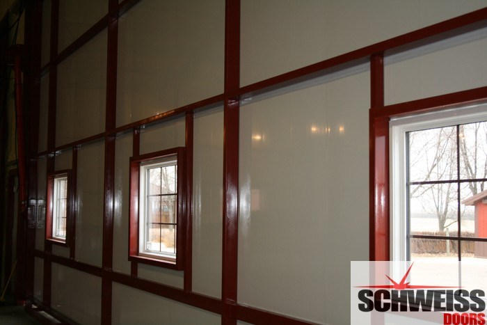 Hydraulic doors brighten up with glass panels or windows  Schweiss Bifold  Hydraulic Doors Blog