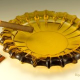 Huge party-size amber cigar ashtray with dual cigarette and cigar rests.