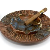 Big Hippie party ashtray with room for all kinds of smokes and paraphernalia. Made of vintage stoneware and glazed in browns, blues and cream. Circa 1970's.