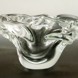 This vintage crystal ashtray was formed by hand-tool from a blob of molten hot colorless glass.