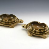 Ashtrays marked Made in Germany. Highly detailed and expertly glazed snapping turtle ashtrays with large cradle rests. Fine examples of vintage German craftmanship.