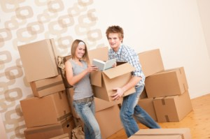Moving house: Young couple with box
