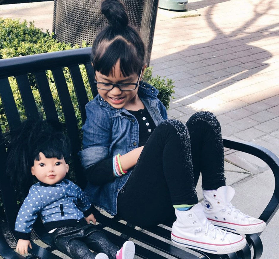 style on bench with doll