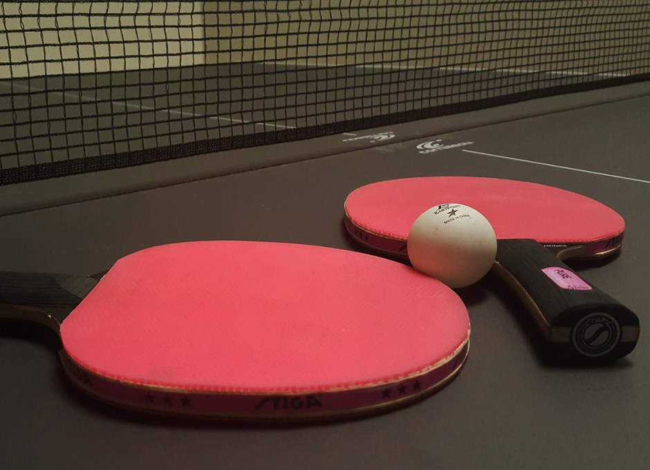 ping pong paddles on table