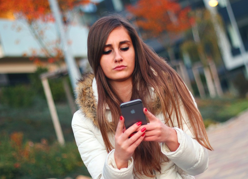 mobile gaming girl on smartphone