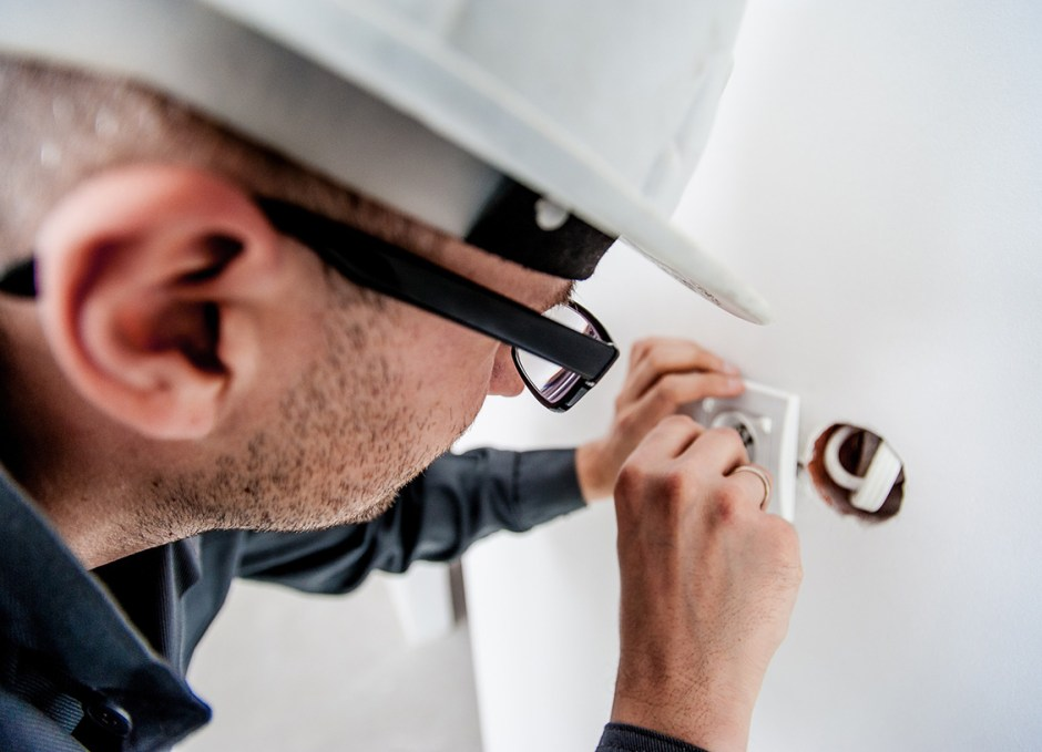 electrical contractor changing outlet