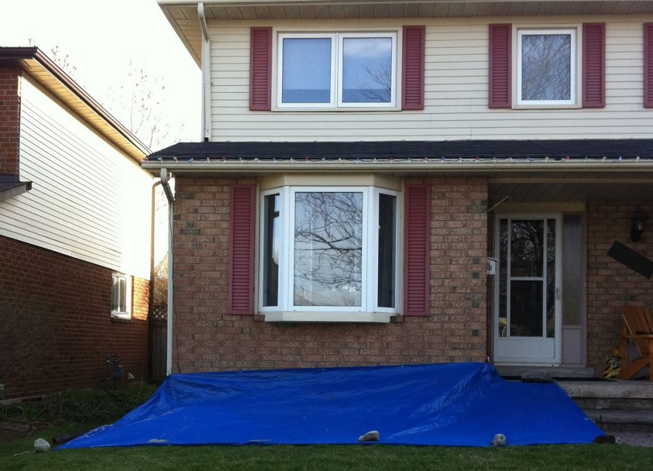 rainy day tarp in front of house