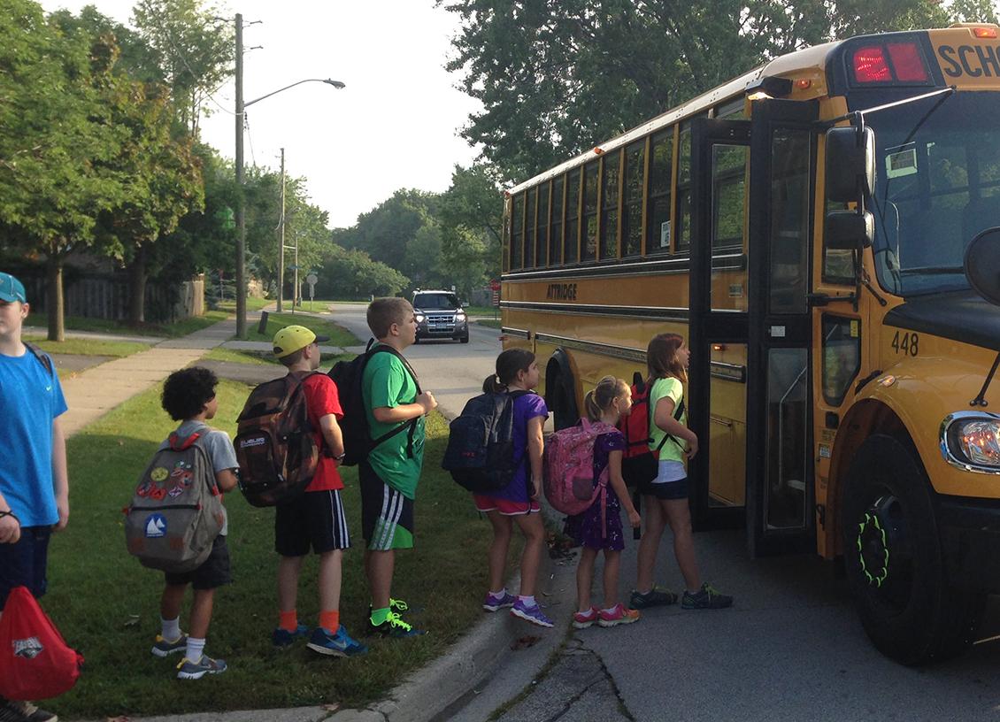 allstate girls at school bus