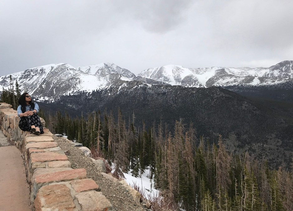 rocky mountain national park girl sitting on wall