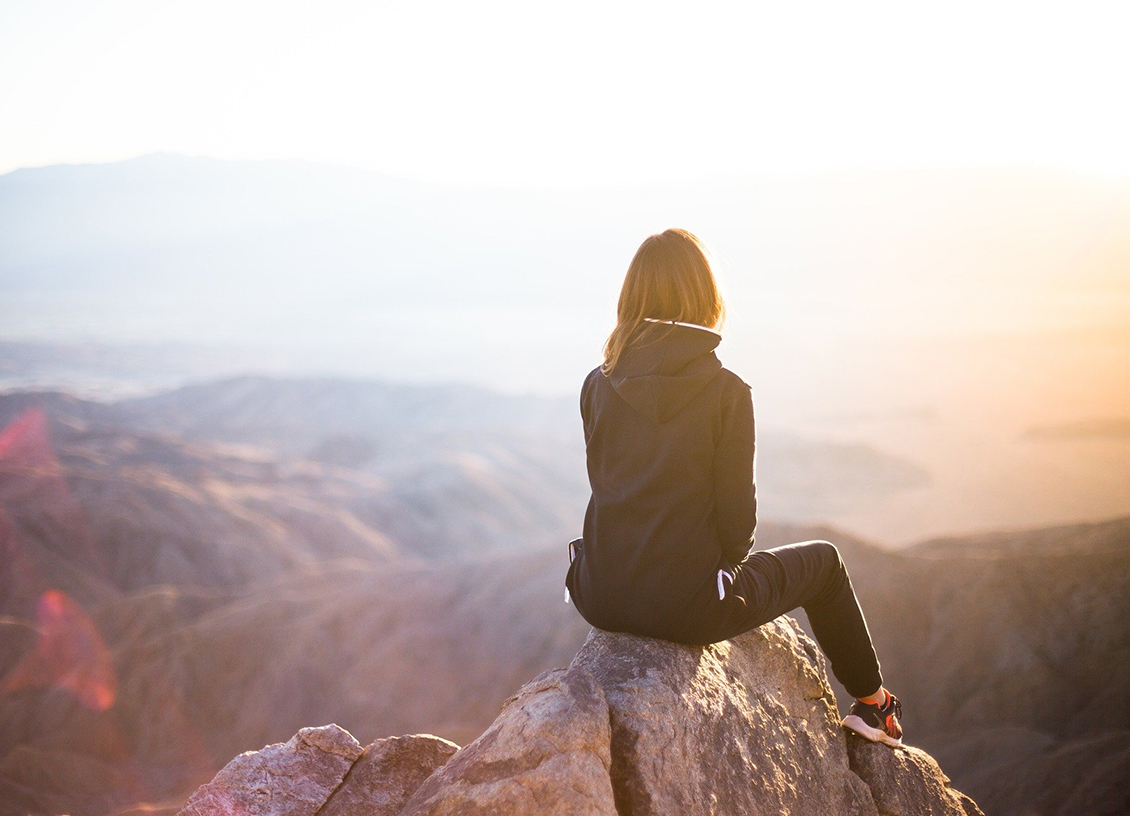 Digital Nomad girl on mountain