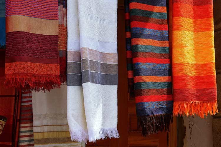 Moroccan fabrics hung up. Bright, vibrant colours