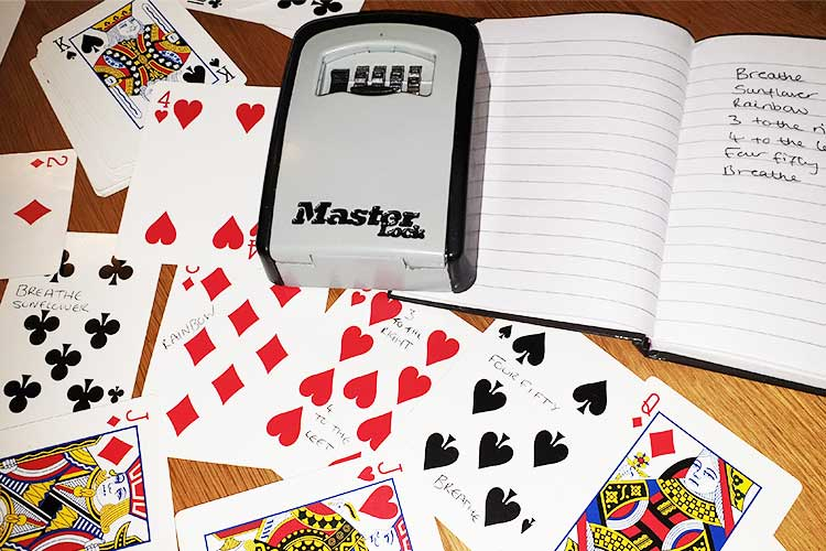 number combination lock and playing cards clues