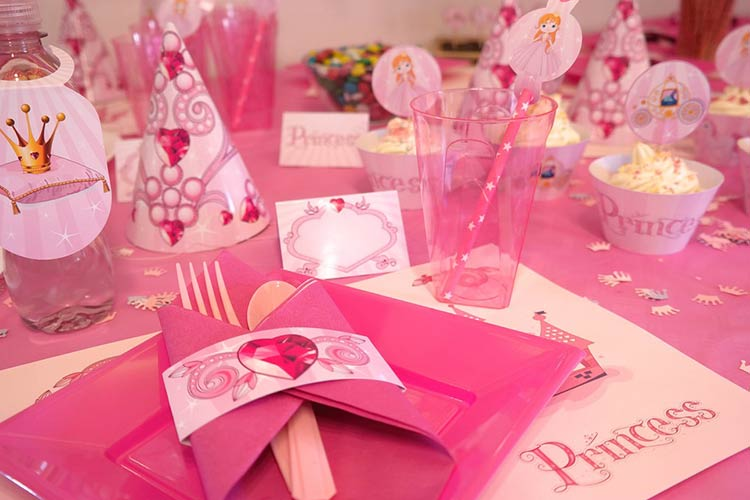 Pink princess party table decorations. Pink plates, cups and napkins.