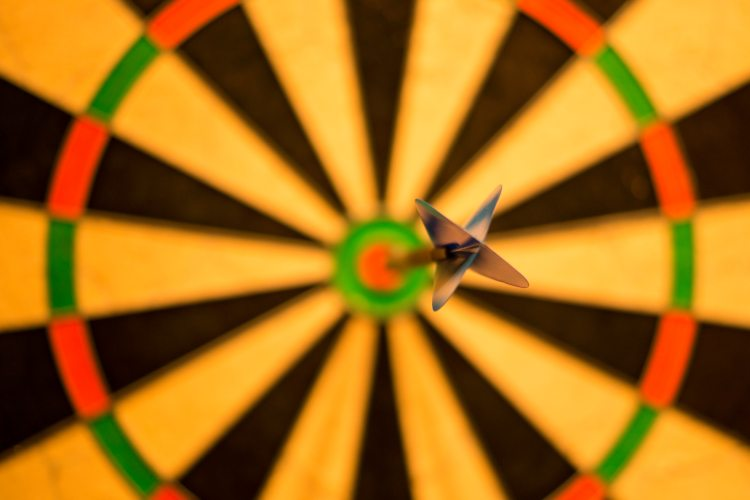 Dartboard with dart on the bullseye