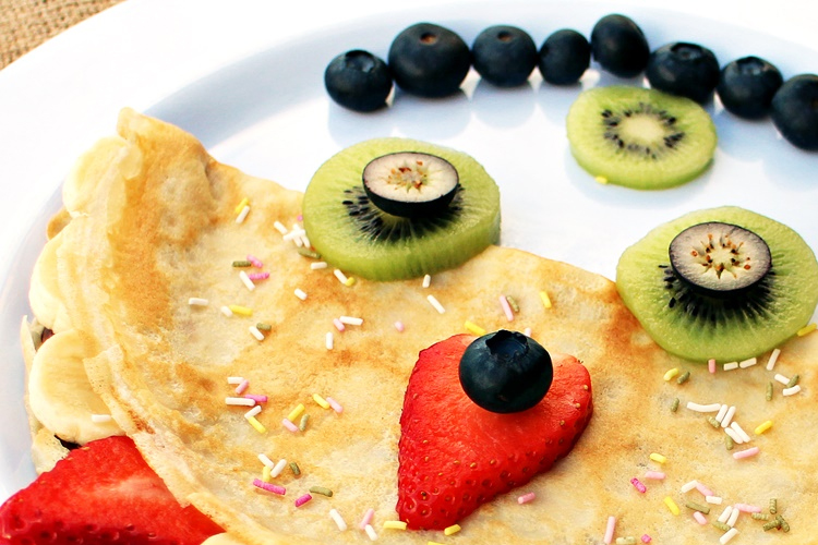 monster face made out of pancakes and fruit