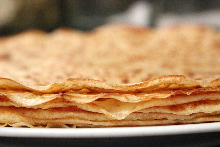 plate full of stacked pancakes