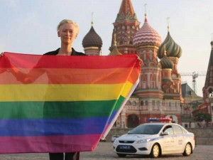 Tilda Swinton holds a rainbow flag in Moscow's Red Square