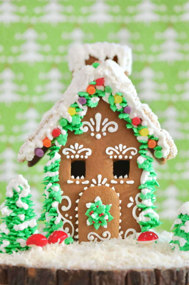 The Ultimate Homemade Gingerbread House Kit fully decorated and assembled.