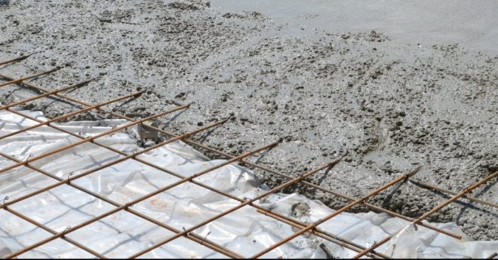 steel mesh grid with wet concrete poured on part