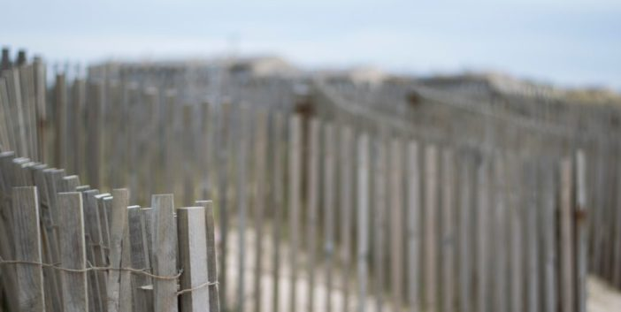 simple wooden fence creating barrier on a beach