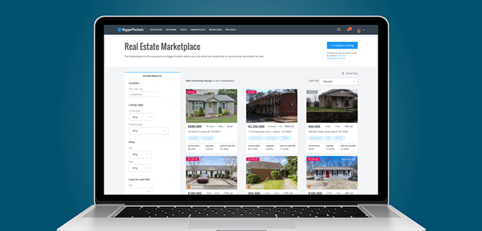 laptop with BiggerPockets Real Estate Marketplace on screen
