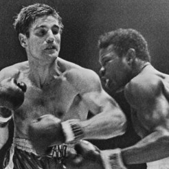 Italian boxer Nino Benvenuti, left, follows through on a left against America's Emile Griffith during their Middleweight Championship Match in Madison Square Garden, New York, on March 4,1968. Benvenuti remained the title with a points decision.(AP Photo)