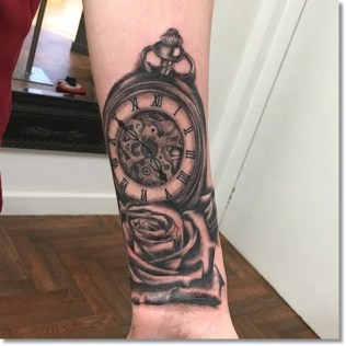 rose-and-pocket-watch-tattoo-forearm