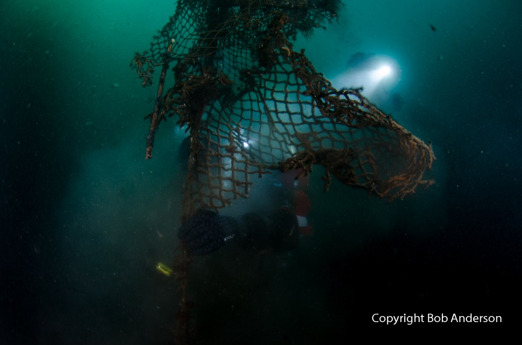 Removing net from the seabed..