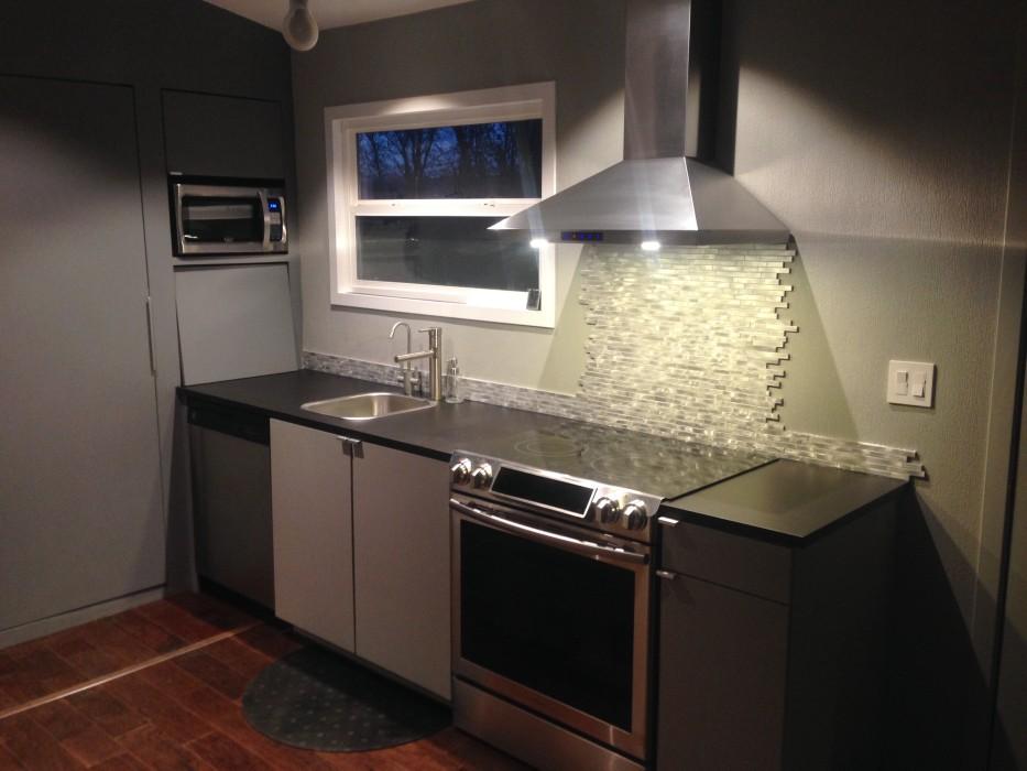 installing kitchen backsplash tall narrow cabinet | big tiny house