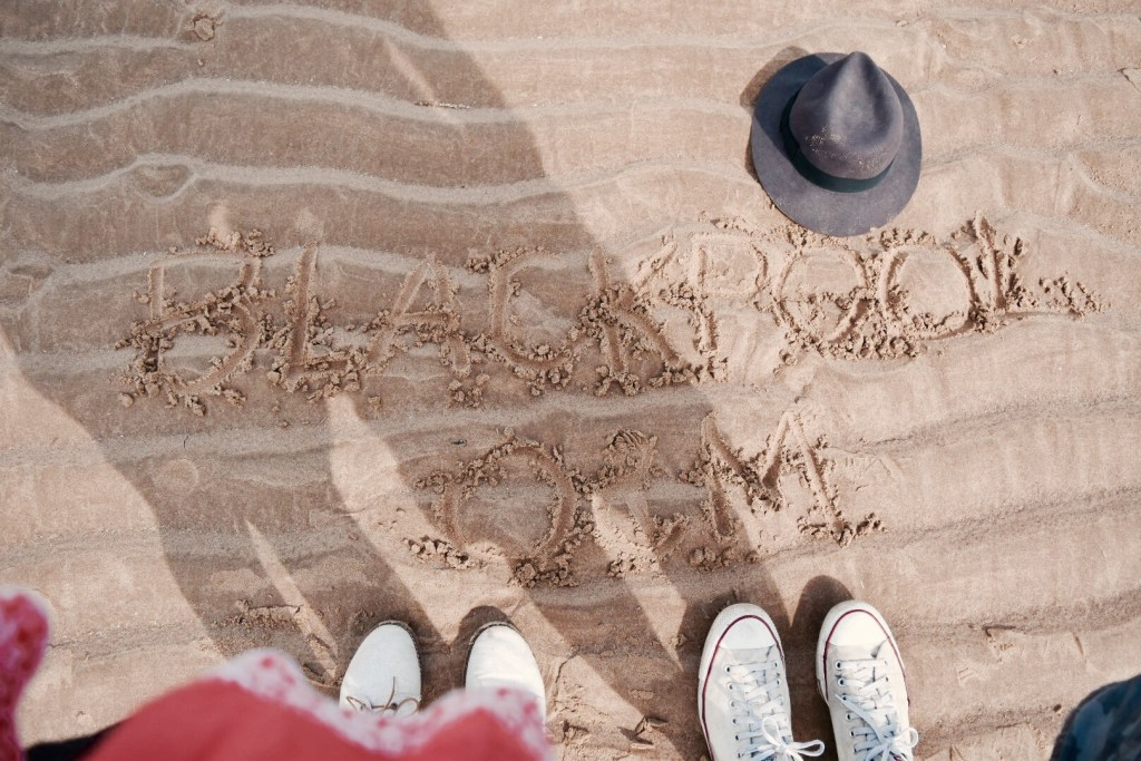 Writing on Blackpool Beach