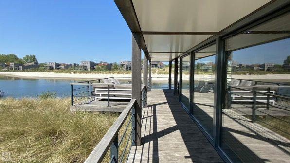 Luxe villa direct aan het strand van Ouddorp Oasis Parc Punt West huisje huren Concert at Sea 16