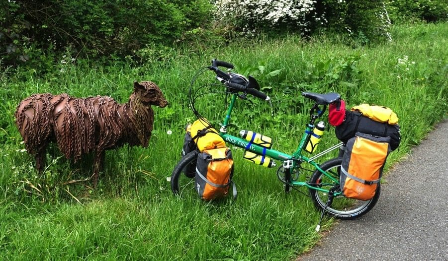 Bike Friday Pocket llama meets a llama sculpture in the UK