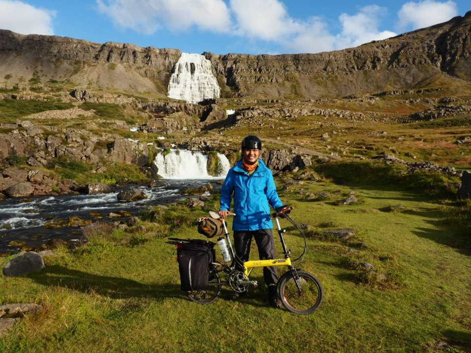 Posing with a Bike Friday folding bike in front of a waterfall in Iceland