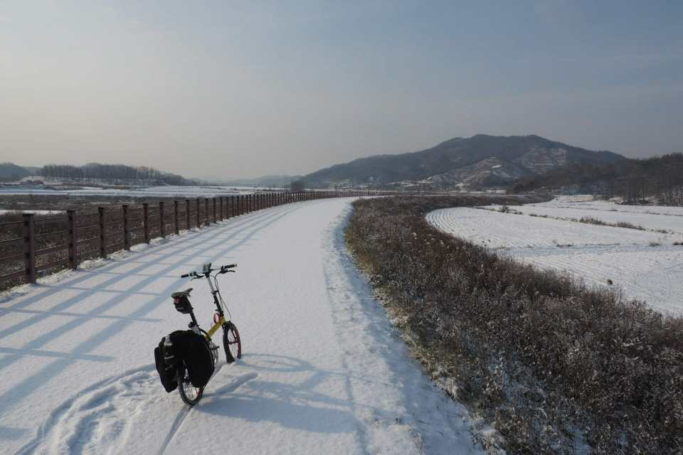 The sun comes out on a snowy bike path while riding from Seoul to Busan Korea