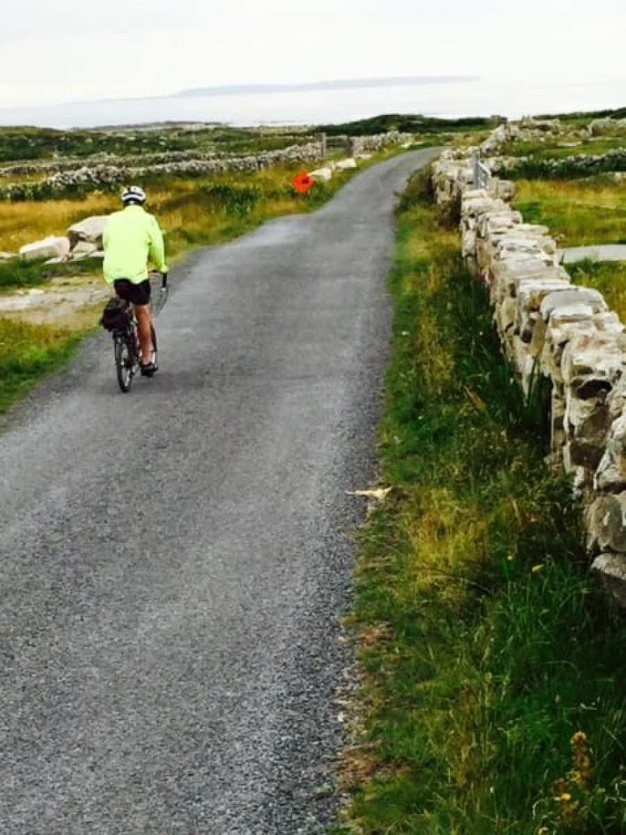 Touring by bike through rocky fields in Ireland