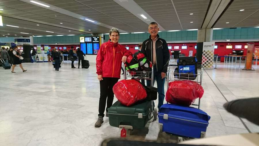 Arriving at the airport with bikes packed into suitcases