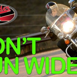 Why motorcycle riders run wide in corners