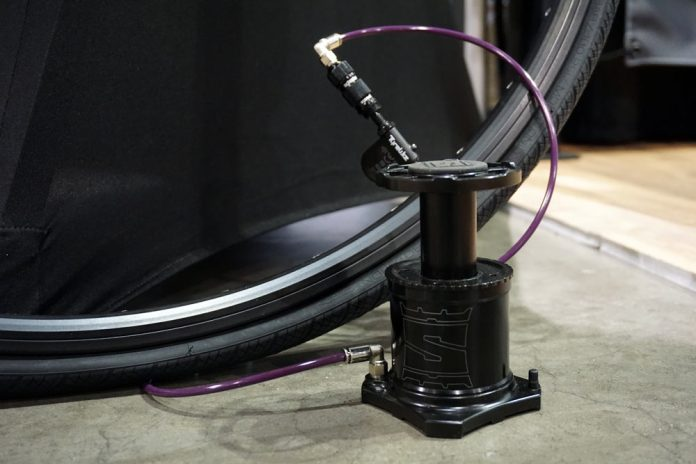 stompump is a mini bicycle tire foot pump that fits on your frame to fill tires faster than mini hand pumps