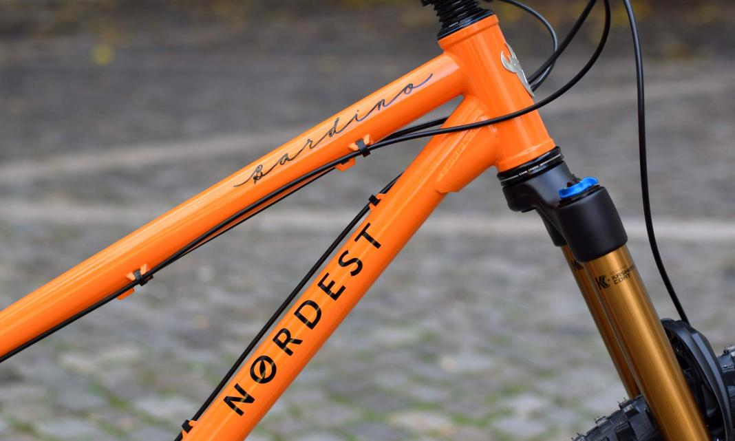 Nordest Cycles custom painted 4130 steel trail mountain bikes orange