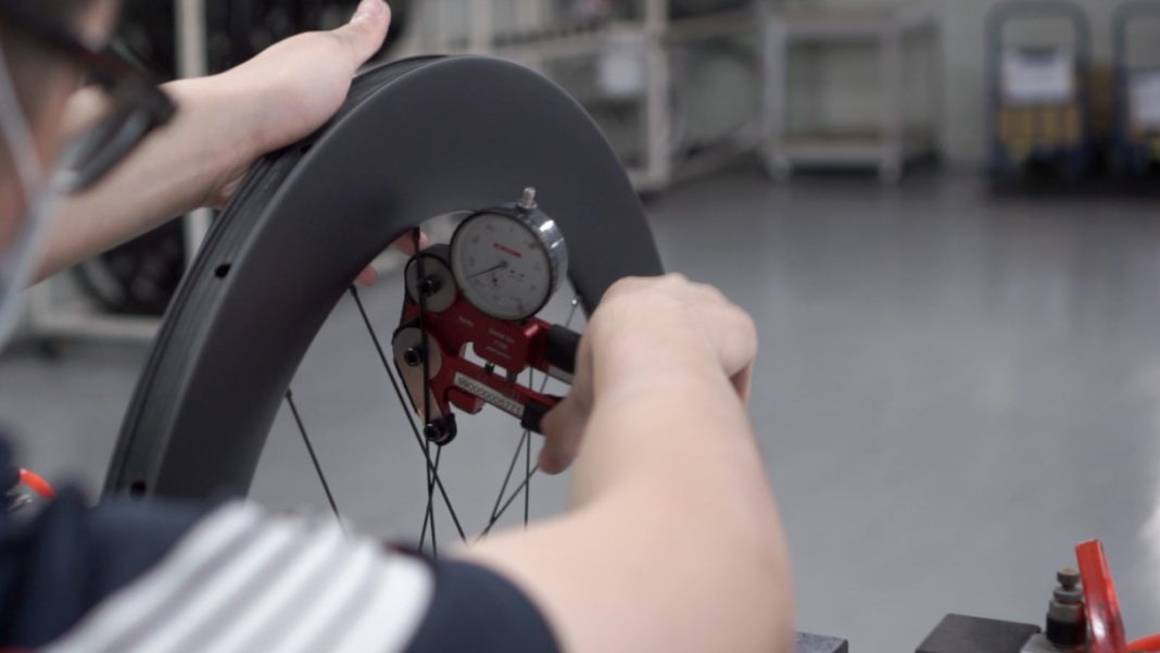 FSA tells whats the difference between handbuilt and machine built road bike and mountain bike wheels