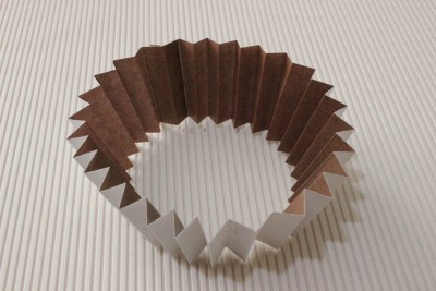 concertina the paper and glue the ends together to make a circle
