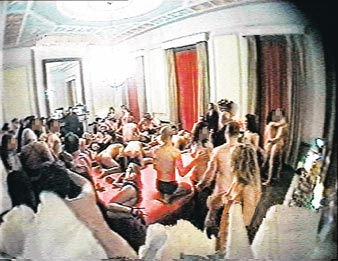 ORGY: Revellers writhe on the huge orgy bed
