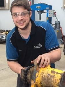 Happy apprentice student at mechanical engineering firm Billet Engineering in Kalgoorlie Western Australia